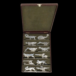 12 animal knife-rests in silvered-plate after Benjamin Rabier